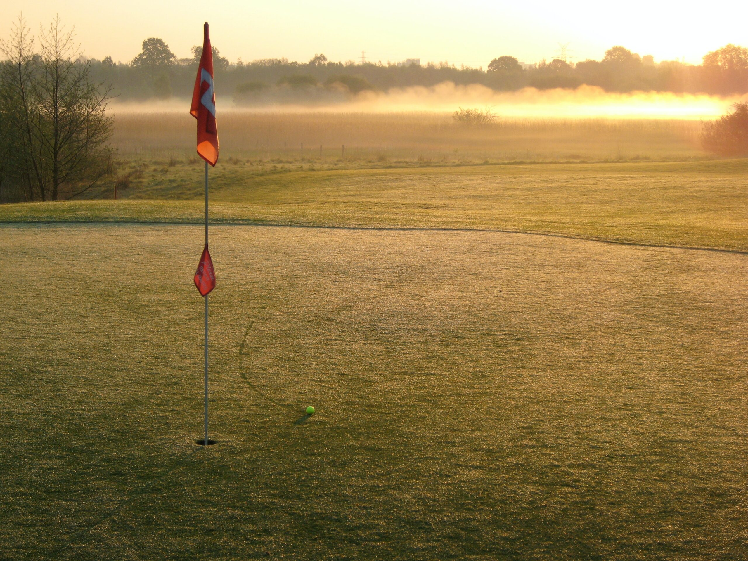 photo of red flag on golf course